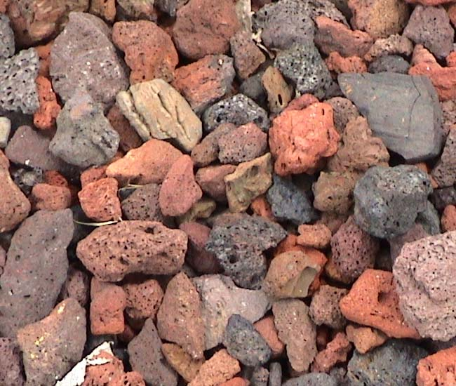 Landscape ideas landscaping lava rocks for Small red rocks for landscaping